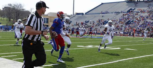 Blue Team quarterback Montell Cozart charges up the sideline on a 60-yard run during the second half of the Kansas Spring Game on Saturday, April 12, 2014 at Memorial Stadium. Nick Krug/Journal-World Photo