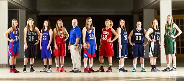 The 2014 Journal-World All-Area Girls Basketball Team, from left, Amber Moore, Santa Fe Trail; Madison Piper, Free State; Katie Jones, Baldwin; Corie Fischer, Ottawa; coach of the year Jayson Duncan, Santa Fe Trail; Shelby Dahl, Santa Fe Trail; Kionna Coleman, Lawrence; Carly Eaton, Mill Valley; Tori Huslig, Veritas Christian; Scout Wiebe, Free State; and Megan Bonar, De Soto.