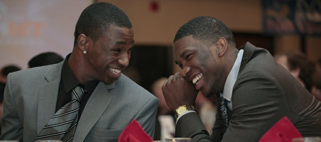 "One-and-done freshmen Andrew Wiggins, left, and Joel Embiid share a laugh during the Kansas University men's basketball postseason awards banquet Tuesday, April 15, 2014, at the Lawrence Holiday Inn. Wiggins, who was given the Danny Manning ""Mr. Jayhawk"" Award, and Embiid declared for this summer's NBA Draft after one season at KU."