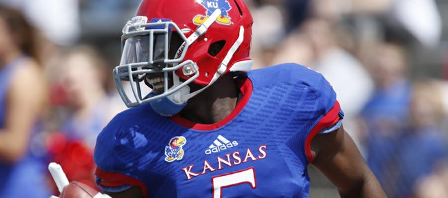 Blue Team safety Isaiah Johnson flashes a smile after intercepting White Team quarterback Michael Cummings during the first half of the Kansas Spring Game on Saturday, April 12, 2014 at Memorial Stadium. Nick Krug/Journal-World Photo