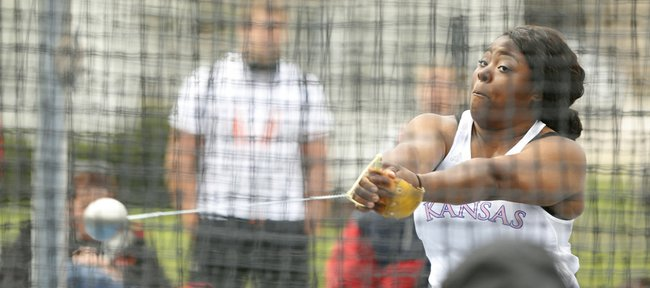 Kansas' Daina Levy spins through her routine as she prepares to throw during the preliminary round of the Hammer Throw event of the Kansas Relays, Thursday, April 17, 2014 outside Memorial Stadium.