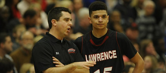 Lawrence High coach Mike Lewis talks with junior Anthony Bonner (15) on Friday, Feb. 28, 2014, at FSHS.