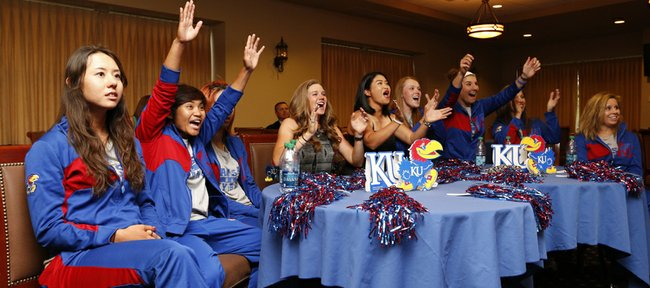 Members of the Kansas University women's golf team react with excitement as the school their seed is announced during a watch party for the 2014 NCAA regional selection show on Monday, April 28, 2014 in Allen Fieldhouse.