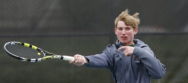Free State High school tennis player David Neff competes in a #2 singles match in the Sunflower League Regional tournament Thursday at Indian Creek Recreation Center in Overland Park.