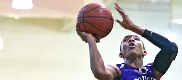 In this file photo from Jan. 2, 2012, Broughton High junior Devonte' Graham (4) goes up for an acrobatic shot during the first half of a game against Enloe High in Raleigh, N.C.