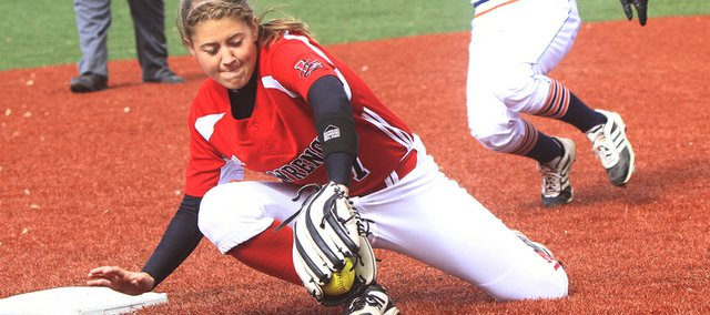 Lawrence High third baseman Morgan Byrn makes a play in the Lions' sweep by Olathe East on Thursday, May 1, 2014, at LHS.