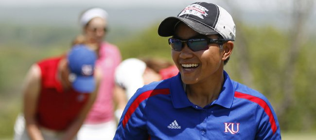 Kansas University sophomore golfer Yupaporn Kawinpakorn smiles as the KU women's golf team practices on the putting greens at Lawrence Country Club on Monday, May 5, 2014. The Jayhawks make their first trip to an NCAA Regional on Thursday in Stillwater, Oklahoma.