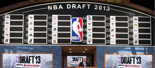 NBA Commissioner David Stern takes the stage at the beginning of the NBA basketball draft, Thursday, June 27, 2013, in New York. (AP Photo/Jason DeCrow)