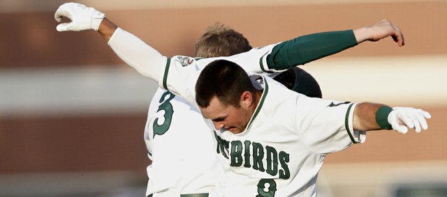 Free State junior Casey Hearnen, (3) left, and Cooper Karlin (9) celebrate after the Firebirds 3-2 win over Lawrence High school Wednesday at FSH. Hearnen drove in Karlin for the winning run in the bottom of the 8th-inning.