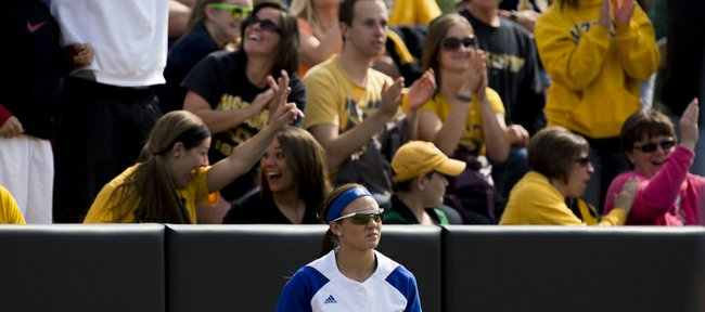 Kansas University's Taylor Hatfield (10) returns from the outfield wall after failing to catch a home run hit by Missouri's Kirsten Mack during their NCAA regional softball game, Saturday, May 17, 2014, at University Field in Columbia, Mo.