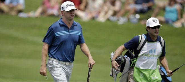 Former Kansas University golfer Chris Thompson approaches the 17th green with his caddie, former KU teammate Jake Istnick, during the third round of the Byron Nelson Championship golf tournament, Saturday, May 17, 2014, in Irving, Texas.