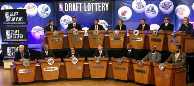 In this May 21, 2013 file photo, NBA basketball team representatives sit onstage at the start of the NBA draft lottery in New York. The draft lottery is Tuesday, May 20, and the winner gets the No. 1 pick in next month's draft. Kansas University teammates and possible top selections Andrew Wiggins and Joel Embiid will be attending the lottery ceremony, according to media reports, and former Jayhawks Marcus and Markieff Morris will represent the Phoenix Suns.
