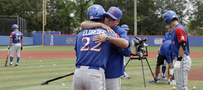 Kansas baseball coach Ritch Prices hugs senior catcher Ka'iana Eldredge before practice, after the Jayhawks found out they made it into the NCAA Tournament and will play University of Kentucky in Louisville, Kentucky, on Friday, May 30, 2014.