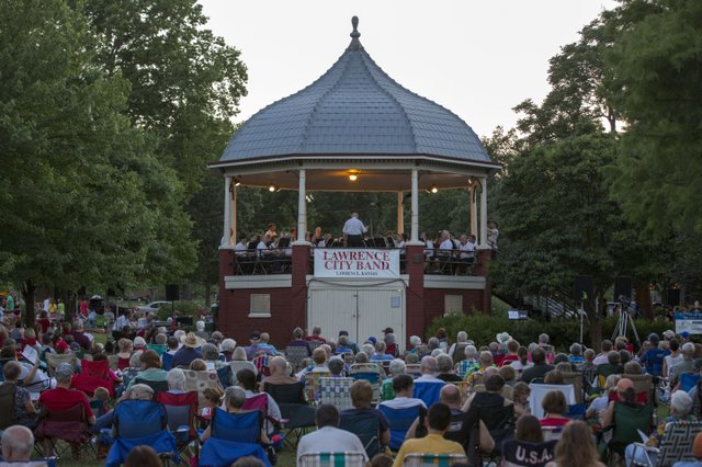 A large crowd gathers around the South Park gazebo to listen to the final Lawrence City Band concert of the summer Wednesday, July 17, 2013.