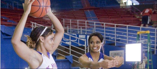 Kansas freshman twins Dakota, (2) left and Dylan Gonzalez,(3) play around between filming videos during the KU women's basketball team media day Wednesday at Allen Field House
