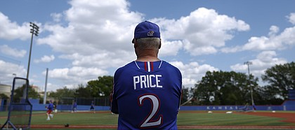 Kansas University baseball coach Ritch Price watches over practice on May 15, 2014, at Hoglund Ballpark. Price has led the Jayhawks to the NCAA Tournament for the third time in his 12 years as KU's head coach.