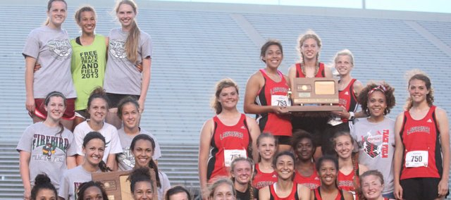 The Free State and Lawrence High girls track and field teams gather with their first- and third-place state trophies, respectively, at the conclusion of the Class 6A championships on Saturday, May 25, 2013, in Wichita.