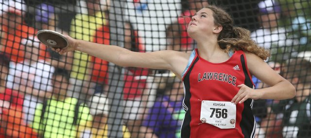 Lawrence High's Matia Finley throws the discus on Friday, May 30, 2014, at the Class 6A state meet in Wichita.