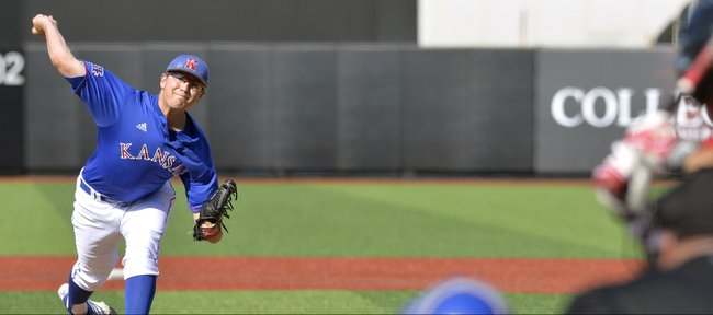 Kansas' Frank Duncan pitches to Louisville during an NCAA college baseball regional tournament game in Louisville, Ky., Saturday, May 31, 2014. (AP Photo/Timothy D. Easley)