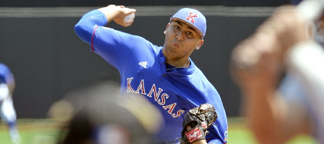 Kansas' Robert Kahana pitches against Kentucky during an NCAA college baseball regional tournament game Sunday, June 1, 2014, in Louisville, Kentucky.