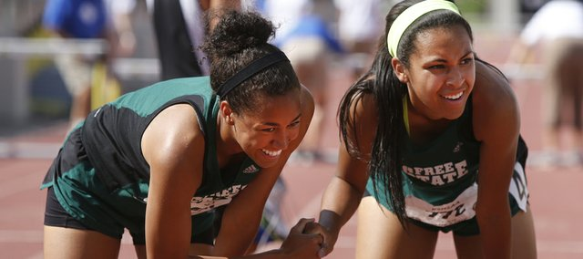 Free State teammates Kiara Clark, left, and Alexa Harmon-Thomas shake hands after taking the top two spots in the 300-meter hurdles, Saturday, May 31, 2014, at the Class 6A state track and field championships in Wichita. Harmon-Thomas won the event — and the 100 hurdles — as the Firebirds girls earned their second straight state championship.