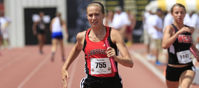 Lawrence High's Jensen Edwards runs the final leg of the 4x100 relay on Saturday in Wichita. LHS took fifth in the event, but Edwards and the Lions girls earned a state title in the 4x400 with a school-record time.