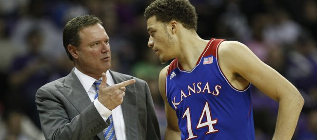 Kansas head coach Bill Self talks with guard Brannen Greene during a break in action against TCU on Saturday, Jan. 25, 2014 at Daniel-Meyer Coliseum in Fort Worth, Texas.