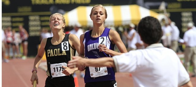 Baldwin's Morgan Lober, center, edges Paola's Lauren Frederick to give Baldwin the state title in the 4x800 on Saturday, May 31, 2014, at the Class 4A meet in Wichita.
