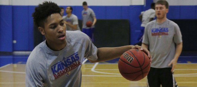 Kansas freshman Kelly Oubre works on his ball handling skills during drills at Bill Self's basketball camp on Tuesday, June 10, 2014, at Horesji Cente