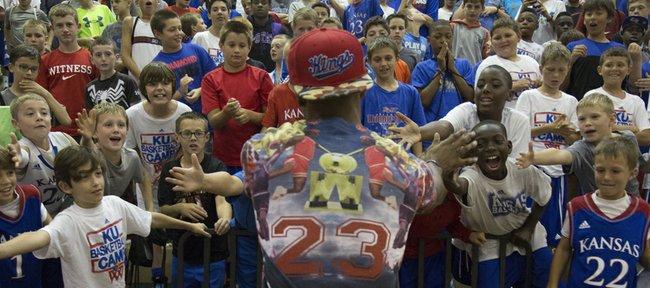 Former Kansas University standout Ben McLemore hands out some high-fives after talking to Bill Self's basket