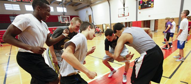 Clockwise from left, Lawrence High players Tae Shorter, Jackson Mallory, Anthony Harvey, Justin Roberts and Kyle Hoffman break out into a dance as the team keeps loose during the start of basketball camp on Monday, June 9, 2014 at Lawrence High School.