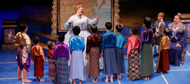 "Anna, played by Sarah Young, leads the children through some singing at the start of a lesson during a dress rehearsal for the Theatre Lawrence production of ""The King and I"" at Theatre Lawrence. The musical opens today and runs through June 29."