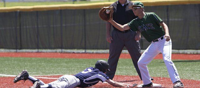 Free State first baseman Parker Tietjen makes a tag on the Lawrence Raiders' Nate Hulse. Hulse was safe on the pickoff attempt.