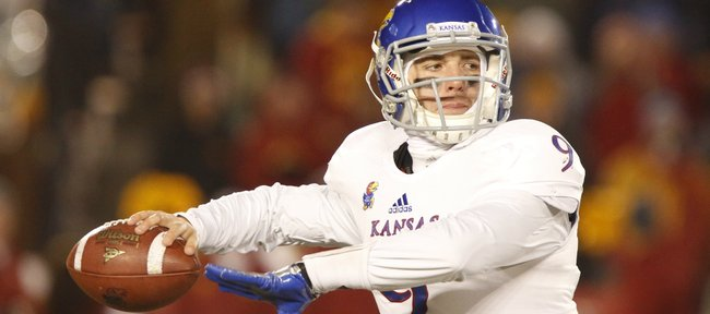 Kansas quarterback Jake Heaps looks to throw to a receiver during the third quarter on Saturday, Nov. 23, 2013 at Jack Trice Stadium in Ames, Iowa.