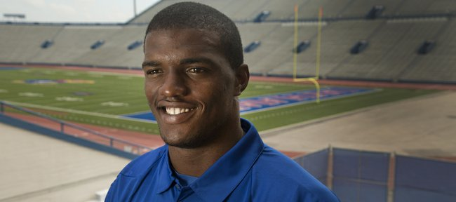 Kansas University senior tight end Jimmay Mundine looks back on his father's death as a moment that began his transformation into the man, the player and the father that he is today.