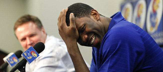 Kansas center Joel Embiid laughs after jokingly being asked to put to bed a rumor that he once killed a lion while growing up in Cameroon, during a news conference on Wednesday, April 9, 2014 at Allen Fieldhouse in Lawrence, Kan.