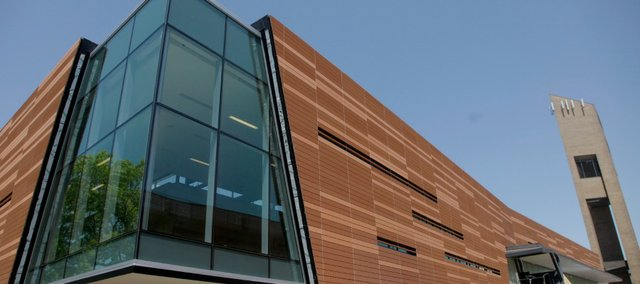 Terra cotta siding and large corner windows provide a dramatic new look to the Lawrence Public Library.