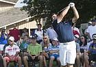 Former Kansas University golfer Gary Woodland demonstrates a tip during a clinic for junior golfers on Monday, June 16, 2014, at Alvamar.