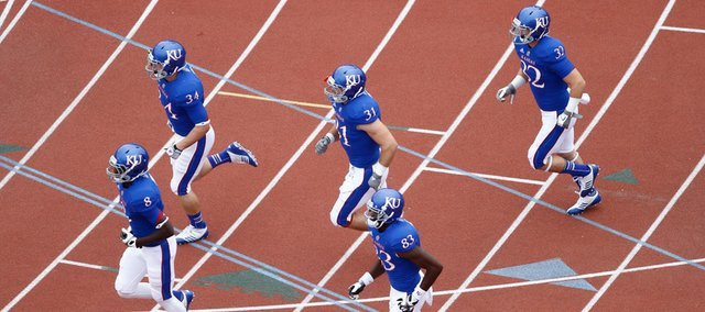 The Kansas Jayhawks take the field prior to kickoff against TCU, Saturday, Sept. 15, 2012 at Memorial Stadium.