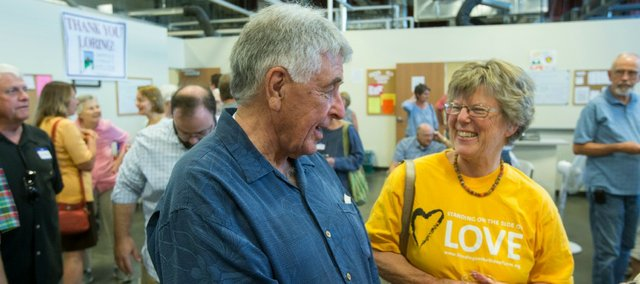 Longtime Lawrence Community Shelter director Loring Henderson, left, shares a laugh with Barbara Schowen, of Lawrence, during a retirement celebration honoring him at the Lawrence Community Shelter, 3655 E. 25th St. on Sunday afternoon.