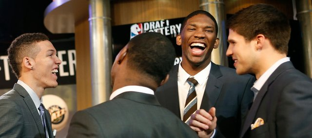 NBA draft prospects Aaron Gordon of Arizona, left, Marcus Smart of Oklahoma Sate (back to camera) Joel Embiid of Kansas, and Doug McDermott of Creighton chat in the studio before the NBA basketball draft lottery in New York, Tuesday, May 20, 2014.