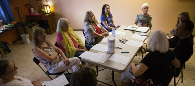Several local residents discuss their thoughts about death at a recent meeting of the Lawrence Death Cafe at Personal Power Pilates Studio, 3115 W. Sixth St.