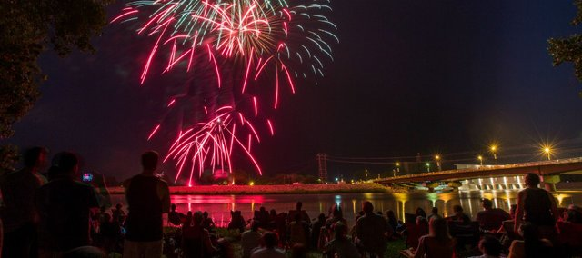 Spectators line the banks of the Kansas River to watch fireworks.