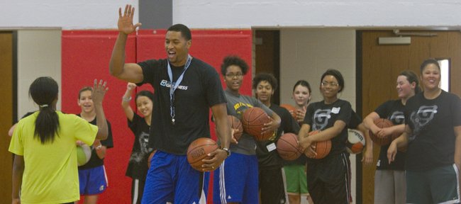 Former NBA player and KU basketball star Wayne Simien leads participants in his Called to Greatness girls basketball camp Thursday, July 3, 2014, at Lawrence High. Simien will hold a boys camp July 8-10.