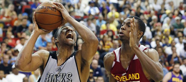 Milwaukee's Jabari Parker, left, drives by Cleveland's Andrew Wiggins in an NBA summer-league game Friday in Las Vegas.