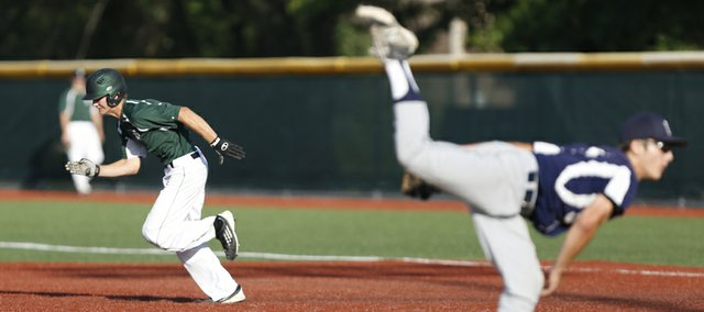 FS Karlin runner Jon Saathoff takes off on a steal as Lawrence Raiders pitcher Ryan Cantrell delivers to the plate during the fifth inning on Tuesday, July 15, 2014, at Lawrence High.