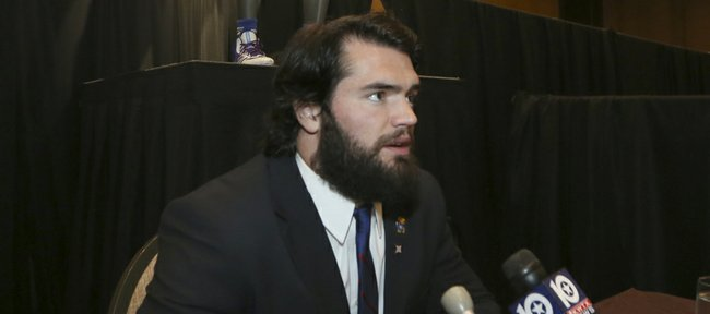 Kansas linebacker Ben Heeney speaks to a reporter during Big 12 media days Monday in Dallas.