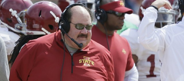 Iowa State offensive coordinator Mark Mangino, center, looks on during Iowa State's annual spring football game, Saturday, April 12, 2014, in Ames, Iowa. (AP Photo/Charlie Neibergall)