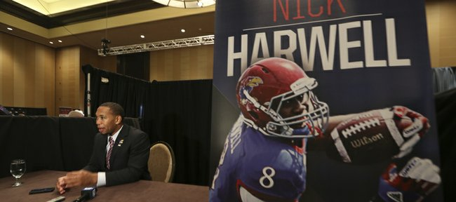 Kansas wide receiver Nick Harwell speaks to a reporter during opening day of Big 12 media days Monday in Dallas.