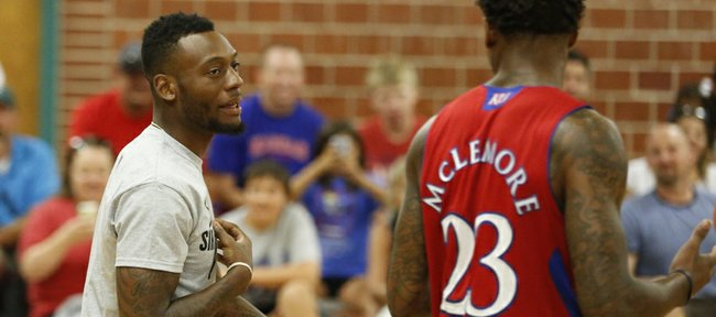 Former Jayhawk Naadir Tharpe, who was on hand for the event, talks dunk strategy with Ben McLemore during the Sir McLemore Summer Slam at the Community Building on Saturday, July 26, 2014.